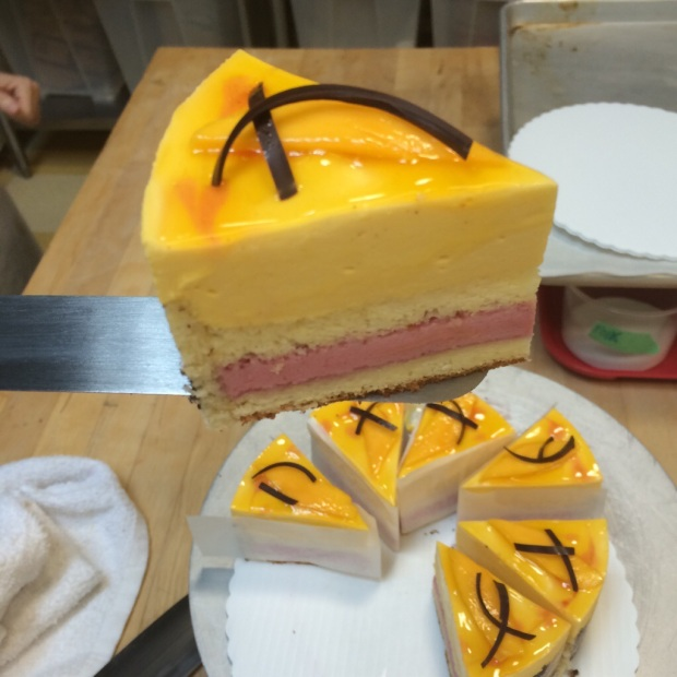 My first entremet cake, layers of sponge cake with raspberry and mango bavaroise (like a mousse).