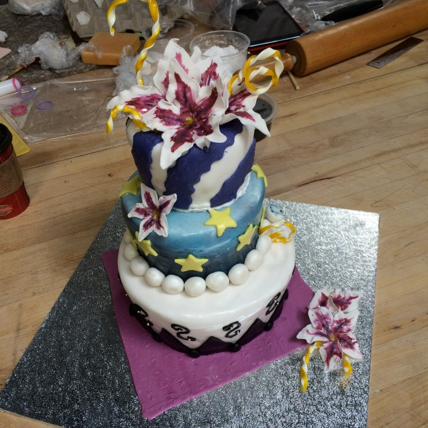 Super fun cake, each tier with a different feel, the top part has sugar curls as well.
