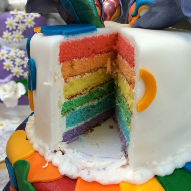 The inside of our cake, all 6-layers of rainbow.